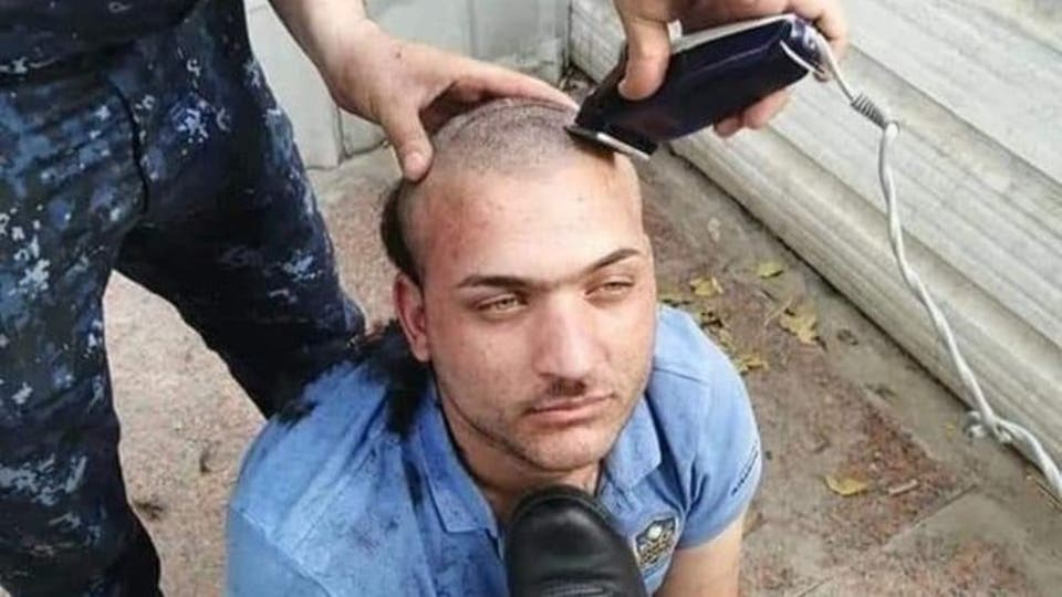 انتقدهم فحلقوا شعره وأذلوه.. فيديو يثير ضجة في العراق